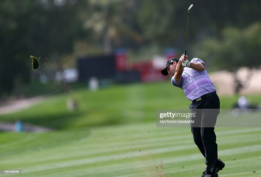 Sergio Garcia of Spain plays a shot during the second round of the Dubai Desert Classic golf tournament in the Gulf emirate of Dubai on February 1, 2013.