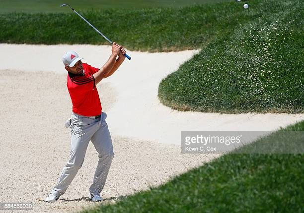 Sergio Garcia of Spain plays a shot from a bunker on the 18th hole during the second round of the 2016 PGA Championship at Baltusrol Golf Club on...