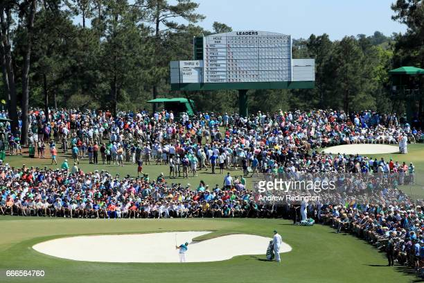 Sergio Garcia of Spain plays a shot from bunker on second hole as patrons look on during the final round of the 2017 Masters Tournament at Augusta...