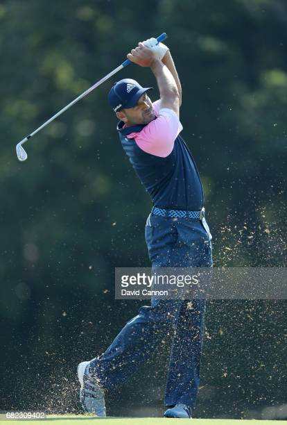 Sergio Garcia of Spain plays his second shot on the par 4 14th hole during the second round of THE PLAYERS Championship on the Stadium Course at TPC...