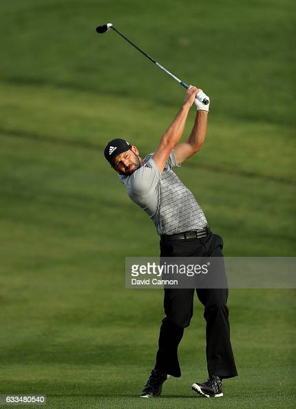 Sergio Garcia of Spain plays his second shot to the par 5 10th hole during the first round of the 2017 Omega Dubai Desert Classic on the Majlis...