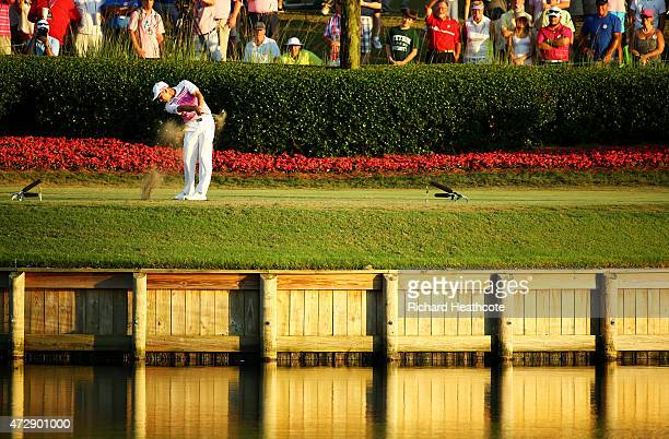 Sergio Garcia of Spain plays his shot from the 17th tee during a playoff in the final round of THE PLAYERS Championship at the TPC Sawgrass Stadium...