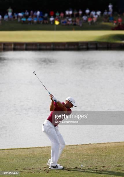 Sergio Garcia of Spain plays his shot from the 17th tee for a hole in one during the first round of THE PLAYERS Championship at the Stadium course at...