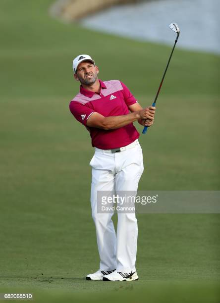 Sergio Garcia of Spain plays his third shot at the par 4 18th hole during the first round of THE PLAYERS Championship on the Stadium Course at TPC...