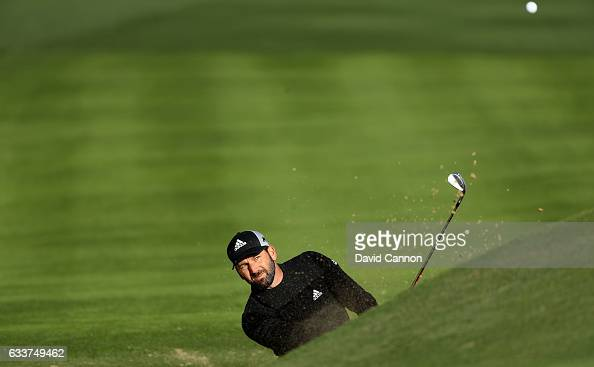Sergio Garcia of Spain plays his third shot on the par 5 10th hole during the completion of the weather delayed second round of the 2017 Omega Dubai...