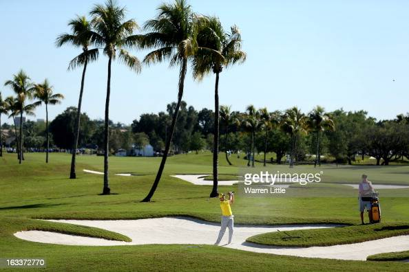 Sergio Garcia of Spain plays out of the 12th greenside bunker during the first round of the WGC Cadillac Championship at the Trump Doral Golf Resort...