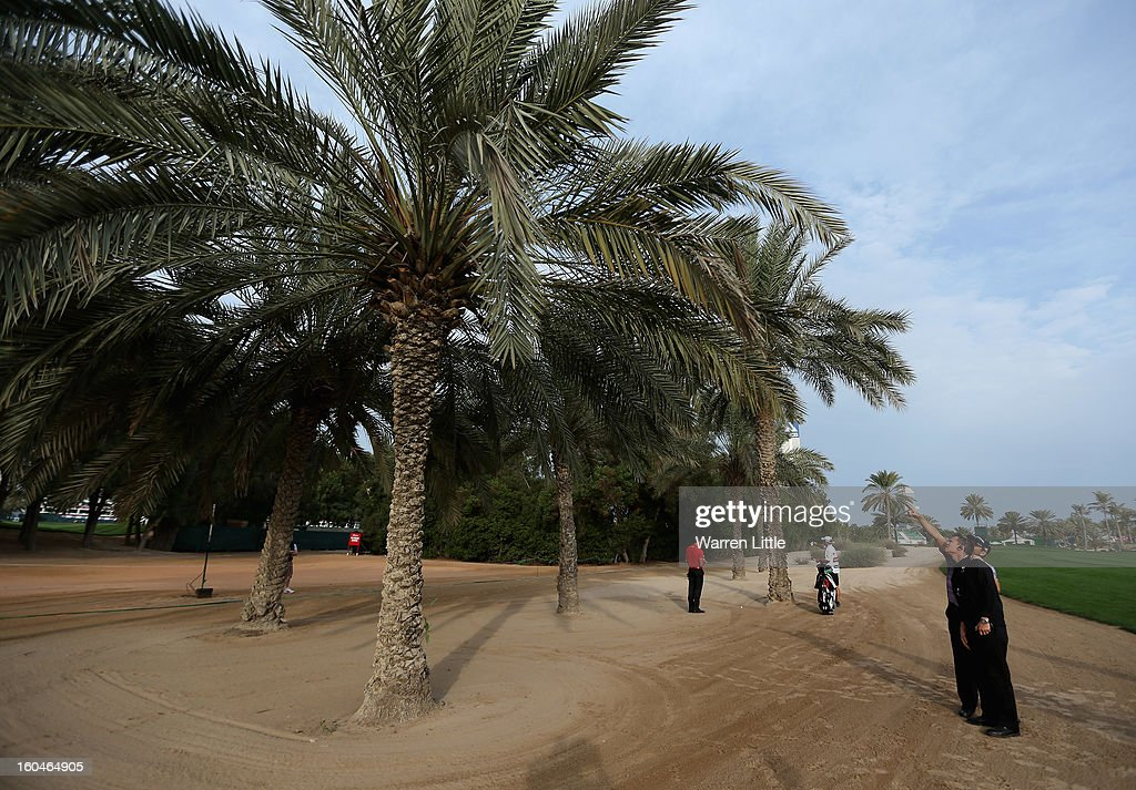 Sergio Garcia of Spain points out his ball to a referee Barney Coleman, which is stuck up a palm tree on the 12th hole during the second round of the Omega Dubai Desert Classic at Emirates Golf Club on February 1, 2013 in Dubai, United Arab Emirates.