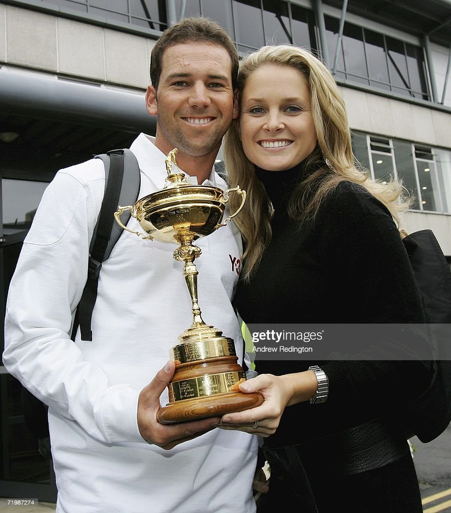 Sergio Garcia of Spain poses with girlfriend MorganLeigh Norman and the Ryder Cup trophy as some of the victorious European Ryder Cup team gather at...