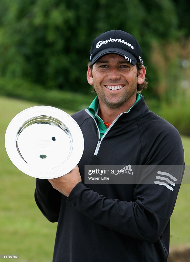 Sergio Garcia of Spain poses with his award for being The European Tour Golfer of the Month for May during the proam for the Euroepean Open at The...