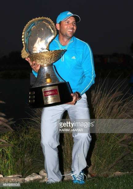 Sergio Garcia of Spain poses with his trophy after winning the final round of the Qatar Masters at the Doha Golf Club on January 25 2014 in Doha...