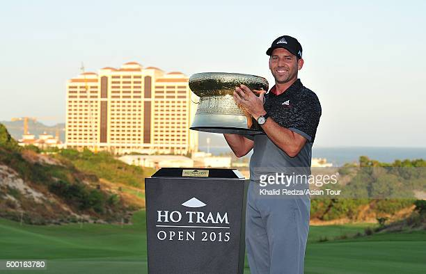 Sergio Garcia of Spain poses with the Ho Tram trophy after he won during round four of the Ho Tram Open at The Bluffs Ho Tram Strip on December 6...