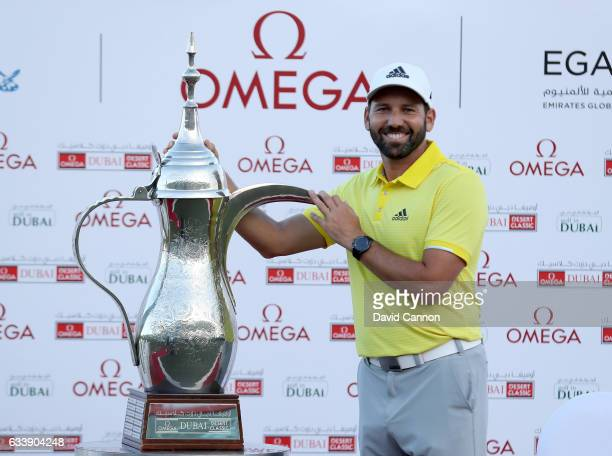 Sergio Garcia of Spain poses with the trophy after his two shot victory during the final round of the 2017 Omega Dubai Desert Classic on the Majlis...