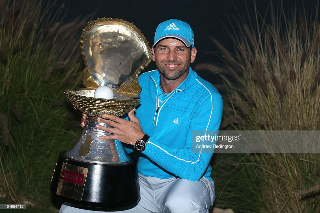 Sergio Garcia of Spain poses with the trophy after winning the Commercial Bank Qatar Masters at Doha Golf Club on January 25 2014 in Doha Qatar