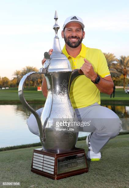 Sergio Garcia of Spain poses with the trophy after winning the final round of the Omega Dubai Desert Classic on the Majlis course at Emirates Golf...