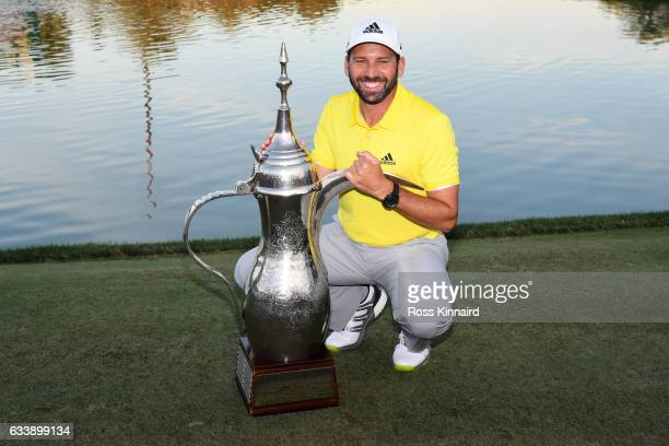 Sergio Garcia of Spain poses with the trophy following his victory during the final round of the Omega Dubai Desert Classic at Emirates Golf Club on...