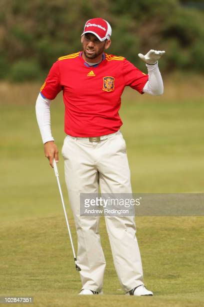 Sergio Garcia of Spain practices wearing his Spain football jersey during practice for the 139th Open Championship on the Old Course St Andrews on...