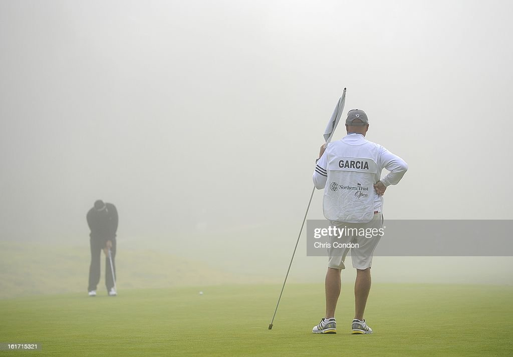 Sergio Garcia of Spain putts for par in the fog on the 8th green during the first round of the Northern Trust Open at Riviera Country Club on February 14, 2013 in Pacific Palisades, California.