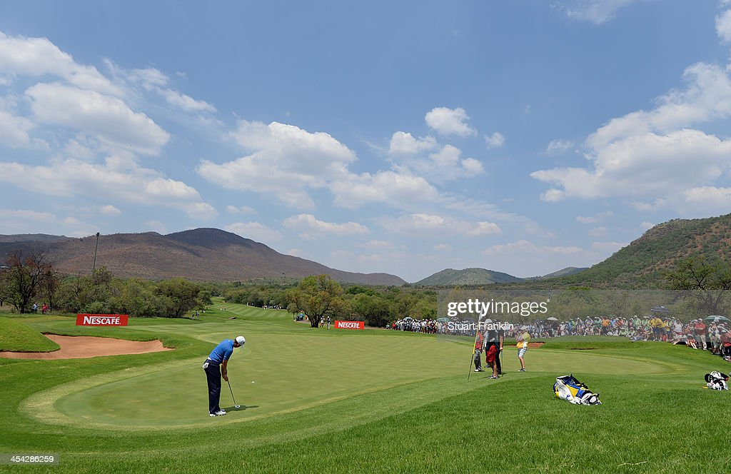 Sergio Garcia of Spain putts on the eigth during the final round of the Nedbank Golf Challenge at Gary Player CC on December 8, 2013 in Sun City, South Africa.