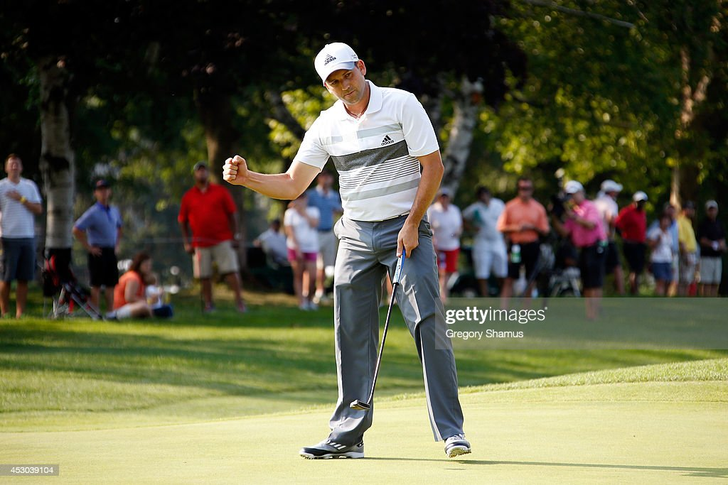 Sergio Garcia of Spain reacts after a birdie putt on the 17th green during the second round of the World Golf Championships-Bridgestone Invitational at Firestone Country Club South Course on August 1, 2014 in Akron, Ohio.