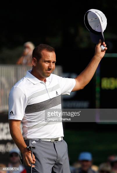 Sergio Garcia of Spain reacts after a birdie putt on the 18th green during the second round of the World Golf ChampionshipsBridgestone Invitational...