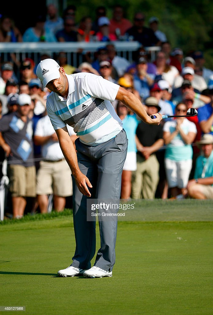 Sergio Garcia of Spain reacts after a putt on the 13th green during the final round of the World Golf Championships-Bridgestone Invitational at Firestone Country Club South Course on August 3, 2014 in Akron, Ohio.