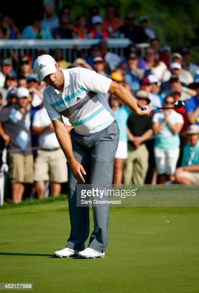 Sergio Garcia of Spain reacts after a putt on the 13th green during the final round of the World Golf ChampionshipsBridgestone Invitational at...