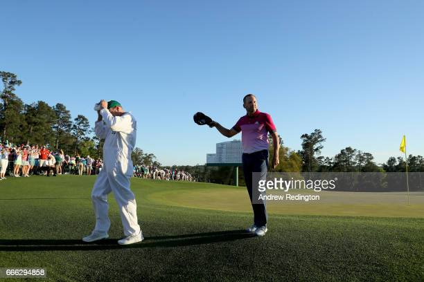 Sergio Garcia of Spain reacts after putting on the 18th hole during the third round of the 2017 Masters Tournament at Augusta National Golf Club on...