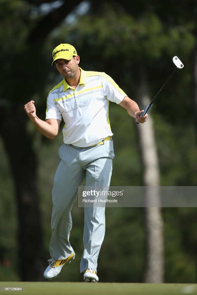 Sergio Garcia of Spain reacts as he holes an eagle putt on the 3rd green during the final round of the Open de Espana at Parador de El Saler on April...
