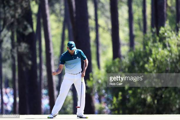 Sergio Garcia of Spain reacts to a putt for birdie on the third hole during the final round of the 2017 Masters Tournament at Augusta National Golf...