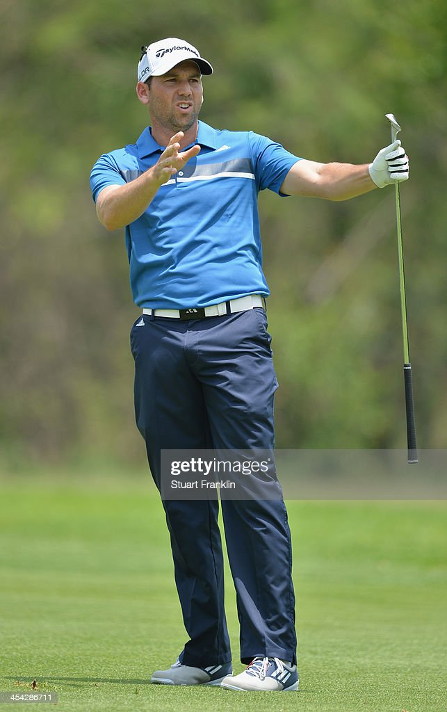 Sergio Garcia of Spain reacts to a shot during the final round of the Nedbank Golf Challenge at Gary Player CC on December 8, 2013 in Sun City, South Africa.