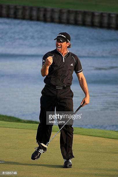 Sergio Garcia of Spain reacts to his made par putt on the green of the 18th hole during the final round of THE PLAYERS Championship on THE PLAYERS...