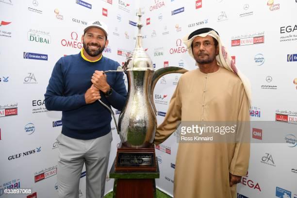 Sergio Garcia of Spain receives the trophy from His Excellency Mubarak Sheikh Fahim Bin Sultan Al Qasimi Chairman of the Emirates Golf Federation...