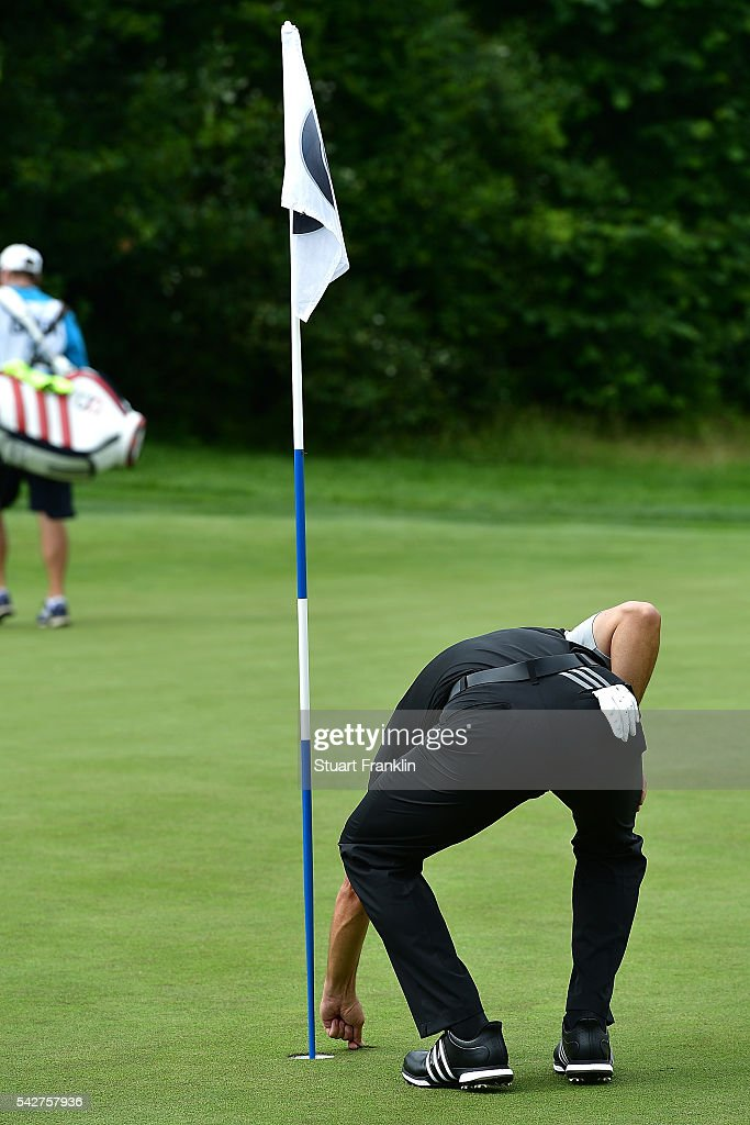 Sergio Garcia of Spain removes his ball from the cup after his hole in one on the 11th hole during the second round of the BMW International Open at Gut Larchenhof on June 24, 2016 in Cologne, Germany.