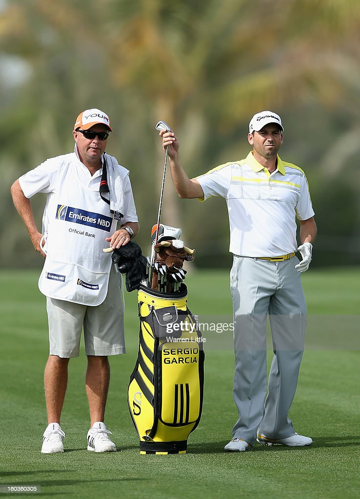 Sergio Garcia of Spain selects a club as caddie Greg Hearmon looks on during the pro-am of the Omega Dubai Desert Classic at Emirates Golf Club on January 30, 2013 in Dubai, United Arab Emirates.