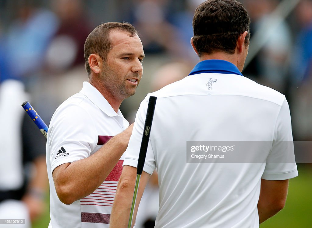Sergio Garcia of Spain shakes hands with <a gi-track='captionPersonalityLinkClicked' href=/galleries/search?phrase=Justin+Rose&family=editorial&specificpeople=171559 ng-click='$event.stopPropagation()'>Justin Rose</a> of England on the 18th green during the third round of the World Golf Championships-Bridgestone Invitational at Firestone Country Club South Course on August 2, 2014 in Akron, Ohio.