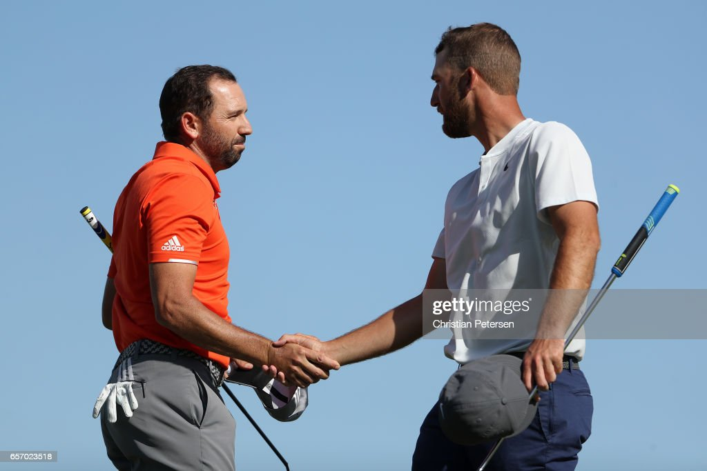 Sergio Garcia (L) of Spain shakes hands with Kevin Chappell after winning their match 4&3 during round two of the World Golf Championships-Dell Technologies Match Play at the Austin Country Club on March 23, 2017 in Austin, Texas.