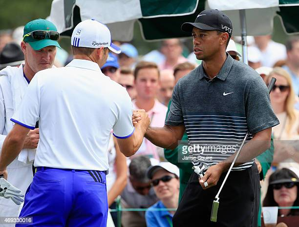 Sergio Garcia of Spain shakes hands with Tiger Woods of the United States on the first tee during the third round of the 2015 Masters Tournament at...
