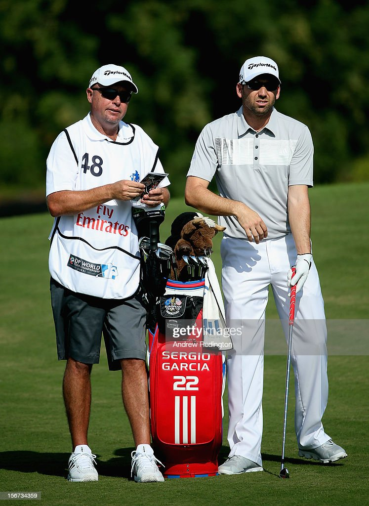 Sergio Garcia of Spain stands with his caddie Greg Hearmon during the Pro Am prior to the start of the Dubai World Championship on the Earth Course at Jumeirah Golf Estates on November 20, 2012 in Dubai, United Arab Emirates.