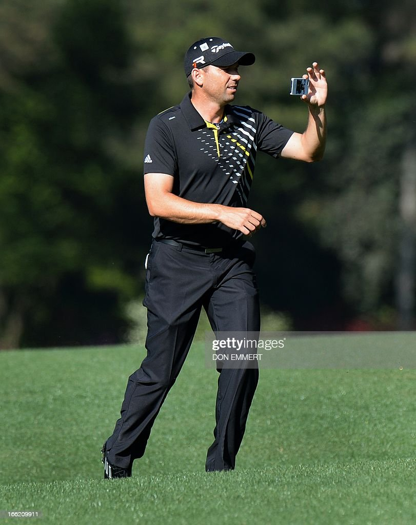 Sergio Garcia of Spain takes a photo with his iPhone during a practice round at the 77th Masters golf tournament at Augusta National Golf Club on April 10, 2013 in Augusta, Georgia.