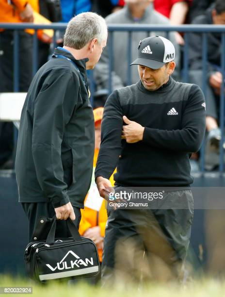Sergio Garcia of Spain talks to the physio on the 7th tee during the second round of the 146th Open Championship at Royal Birkdale on July 21 2017 in...