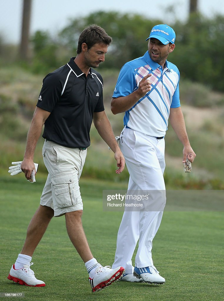 Sergio Garcia of Spain talks with playing partner ATP Tour tennis player <a gi-track='captionPersonalityLinkClicked' href=/galleries/search?phrase=Juan+Carlos+Ferrero&family=editorial&specificpeople=167166 ng-click='$event.stopPropagation()'>Juan Carlos Ferrero</a> during the pro-am for the Open de Espana at Parador de El Saler on April 17, 2013 in Valencia, Spain.