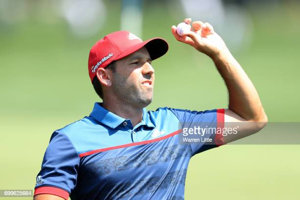 Sergio Garcia of Spain throws his ball on the 3rd green during day one of the BMW International Open at Golfclub Munchen Eichenried on June 22 2017...