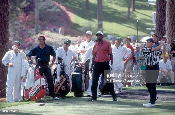 Sergio Garcia of Spain tracking his tee shot alongside Vijay Singh of Fiji and Severiano Ballesteros of Spain during the US Masters Golf Tournament...