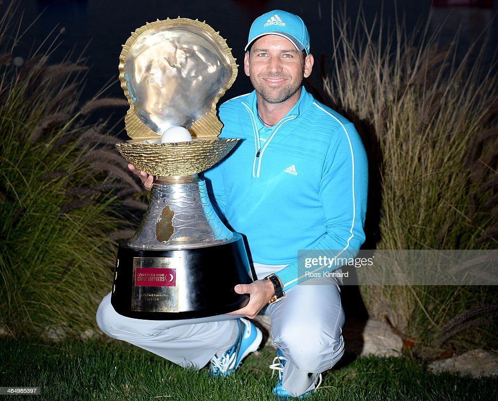 Sergio Garcia of Spain with the winners trophy after the final round of the Comercial Bank Qatar Masters at the Doha Golf Club on January 25 2014 in...