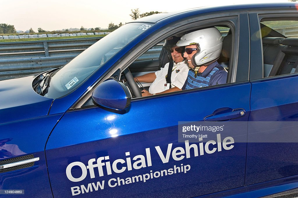 Sergio Garcia take a BMW for a test drive to raise money to benefit the Evans Scholars Foundation at Autobahn Racetrack on September 13, 2011 in Joliet, Illinois.