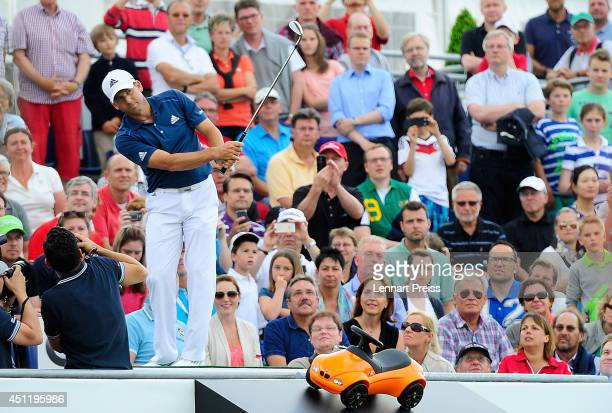 Sergio Garcie hits a shot during the HoleInOne Game during the Opening Show of the BMW International Open 2014 on June 24 2014 in Cologne Germany
