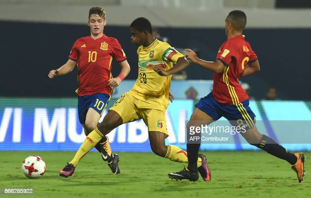 Sergio Gomez of Spain and Cheick Oumar Doucoure of Mali vie for the ball during the second semi final football match between Mali and Spain in the...
