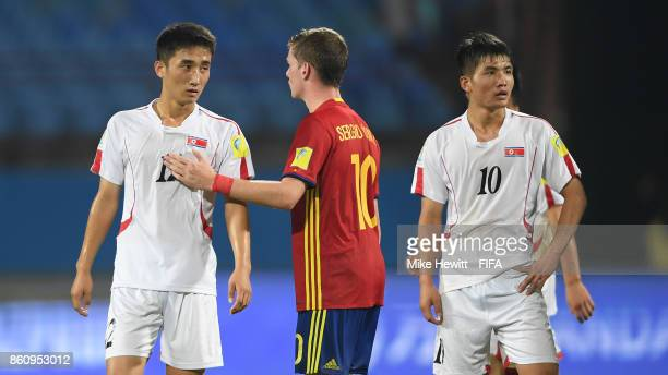Sergio Gomez of Spain consoles Ri Kang Guk of Korea DPR at the end of the FIFA U17 World Cup India 2017 group D match between Spain and Korea DPR at...