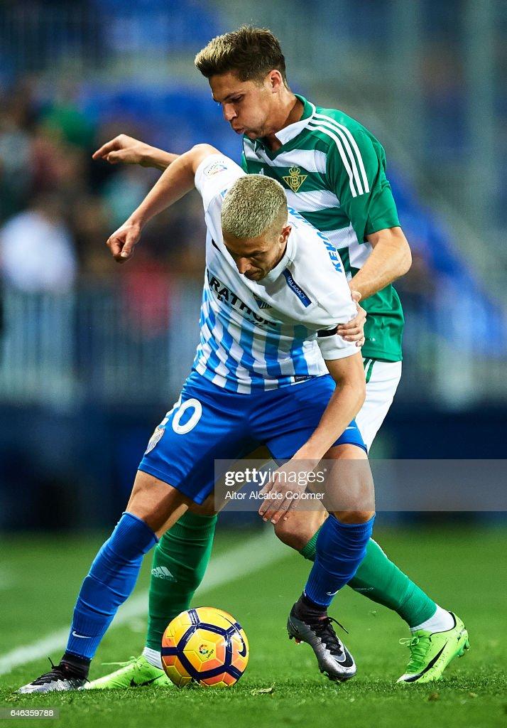 Sergio Gontan 'Keko' of Malaga CF (L) competes for the ball with Jonas Martin of Real Betis Balompie (R) during La Liga match between Malaga CF and Real Betis Balompie at La Rosaleda Stadium February 28, 2017 in Malaga, Spain.