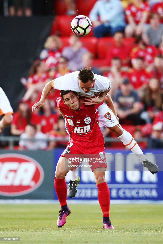 Sergio Guardiola of Adelaide United and Jade North of Brisbane Roar compete for the ball during the round six A-League match between Adelaide United and Brisbane Roar at Coopers Stadium on November 11, 2016 in Adelaide, Australia.